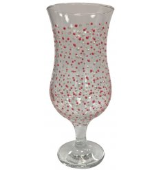 Enjoy your favourite cocktail in this tall cocktail glass with a pink and silver dot design.