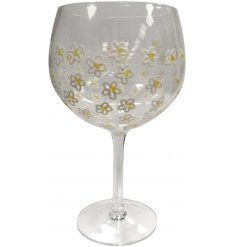 A hand decorated gin glass with a daisy design. A lovely gift item for her.