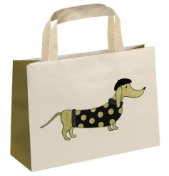 A chic and stylish dachshund design gift bag with jewels and glitter and a fabric carry handle.