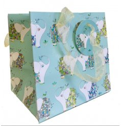 Compliment any gift giving event with this beautifully patterned Gift Bag