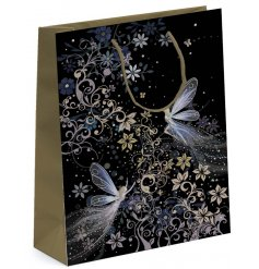 A beautifully whimsical fairy themed gift bag featuring golden toned handles for an added charm