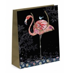 A beautifully flamboyant flamingo themed gift bag featuring golden toned handles for an added charm
