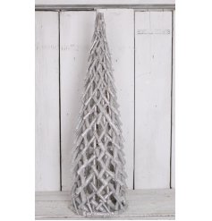 A rustic style criss cross tree with a silver glitter finish.
