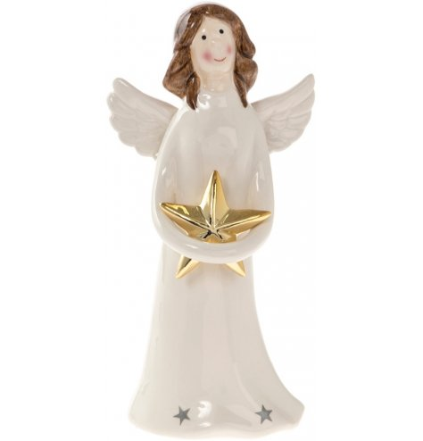 This standing angel is very gentle on the eye in soft white holding a large gold star.