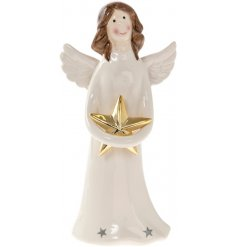 A sweet angel figurine with a gold Christmas star.