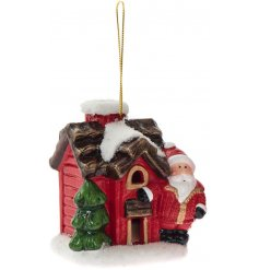 A beautifully detailed festive house with a Santa figure. This hanging decoration has an LED light inside.