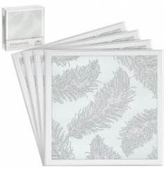 A set of 4 square coasters with silver glitter feathers on a mirrored background.