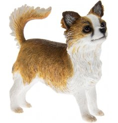 A fine quality longhaired chihuahua dog figurine.