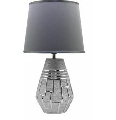 A stylish table lamp with shade included. Stay on trend with this textured metal lamp base with a geometric design.