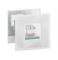 A stylish mirrored glass t-light holder with a silver glitter feather design
