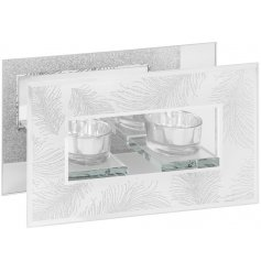 A stunning glass mirror t-light holder with a silver glitter feather design.