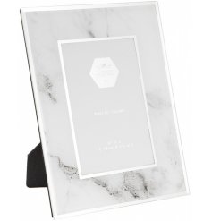 A stylish marble frame with mirror. A chic and elegant interior accessory with an on trend design.