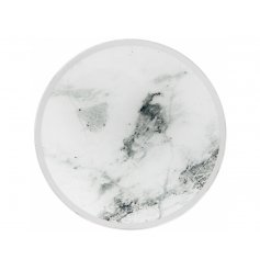 A chic mirror candle plate with a marble design. A beautiful accessory to set beneath your candles.