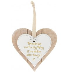 A heart shaped wooden hanging decoration featuring a sentimental friendship themed quote in gold.