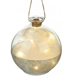 A beautiful glass bauble with a glitter band, led lights and white feathers. Create that wow factor in your window displ