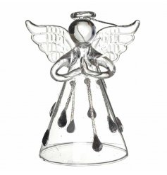 A chic glass angel with a wide skirt decorated with glitter droplets.
