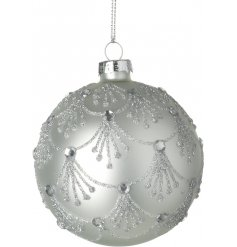 An elegant silver glass bauble with an ornate silver glitter decoration and gems.