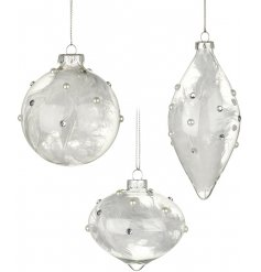 An assortment of 3 elegantly shaped glass baubles with white feathers inside.