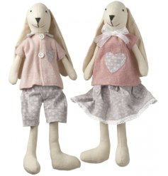 A mix of 2 boy and girl bunny decorations. Each is dressed in a beautiful twee outfit.