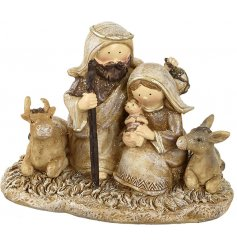 A traditional nativity scene ornament with a touch of Christmas sparkle.
