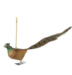 An ornate gold pheasant decoration with feather tail