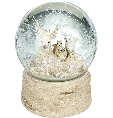 A woodland inspired snow globe with a birch effect base.