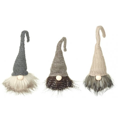 An assortment of 3 gonks in grey and brown woodland colours.