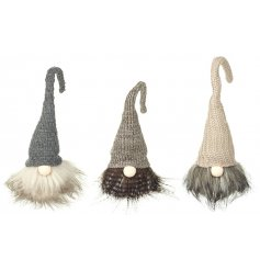 An assortment of 3 charming woodland style gonk decorations with knitted hats and faux fur beards.