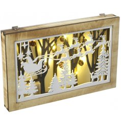 A beautiful wooden wall art with a Santa Sleigh silhouette. Complete with pinecones and woodland features.