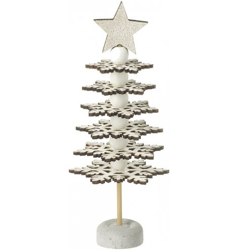 A chic, layered snowflake tree with a star topper and plenty of Christmas glitter.