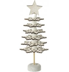 A unique wooden tree decoration with snowflakes and a gold glitter star.