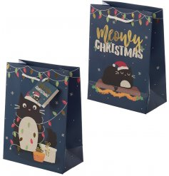 Bring a purrfect touch to your gift giving events with this charming navy blue gift bag covered with a pretty kitty dec