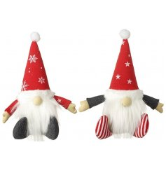 A mix of 2 adorable sitting Santa decorations, each with star and snowflake design outfits.