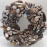 A fine quality wreath with silver beads and wooden natural foliage.