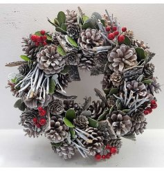 A full and festive wreath with pinecones, twigs and red berries. Complete with a frosted finish.