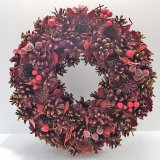A stunning rich red wreath with frosted red berries and pine cones. A stylish festive essential for the home.