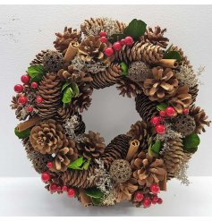 A fine quality berry and dried flower wreath with pinecones. An attractive Christmas essential.