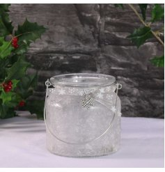 A chic glass t-light holder with a silver snowflake and ribbon. A stylish lantern with a frosted finish.