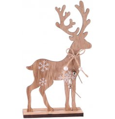 A chic wooden reindeer decoration with white painted snowflakes and silver jingle bells.
