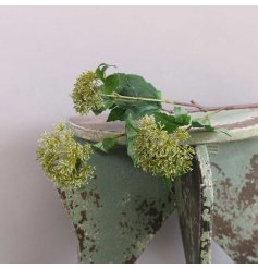 An artificial spray of green snowballs, a perfect accessory for any decorative vase or jug in the home