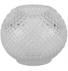 A vintage inspired glass votive with a decorative cut glass pattern. A chic and timeless interior accessory.