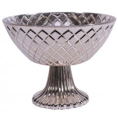 Bring a silver luxe inspired edge to any home space with this large pedestal shaped bowl with an added embossed decal