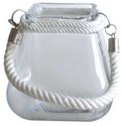 A small clear glass candle pot in a square shape, perfectly finished with a chunky white rope handle for decoration