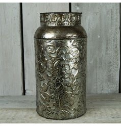 A tall standing Zinc Vase featuring a beautifully tarnished floral embossment and an added distressed charm
