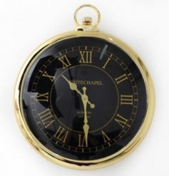 A stylish pocket watch style gold clock with a black face and gold roman numerals.