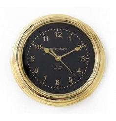 Add some glamour to the home with this on trend, gold and black wall clock.