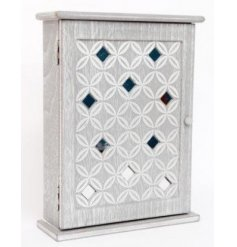 A shabby chic style wooden key box with a geometric mirror design.