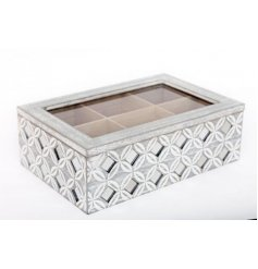 A shabby chic style wooden tea box with a beautiful geometric mirror design pattern.