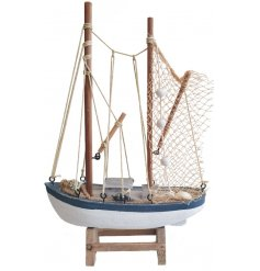 this nautical coloured wooden fishing boat will be sure to add a coastal sense to any space they're in