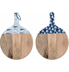 An assortment of large round wooden chopping boards, each featuring a Coastal Charm inspired enamel print